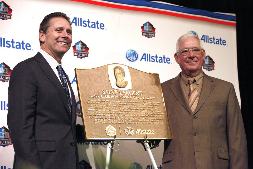 Photo - Former Putnam City star and Pro Football Hall of Fame wide receiver Steve Largent poses for a photo with his