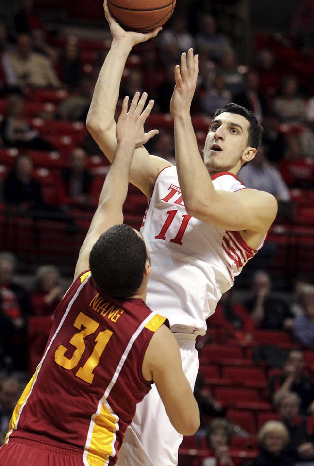 Texas Tech's Dejan Kravic (11) shoots over Iowa State's Georges Niang during their NCAA college basketball game, Wednesday, Jan. 23, 2013, in Lubbock, Texas. (AP Photo/The Avalanche-Journal, Stephen Spillman) ALL LOCAL TV OUT