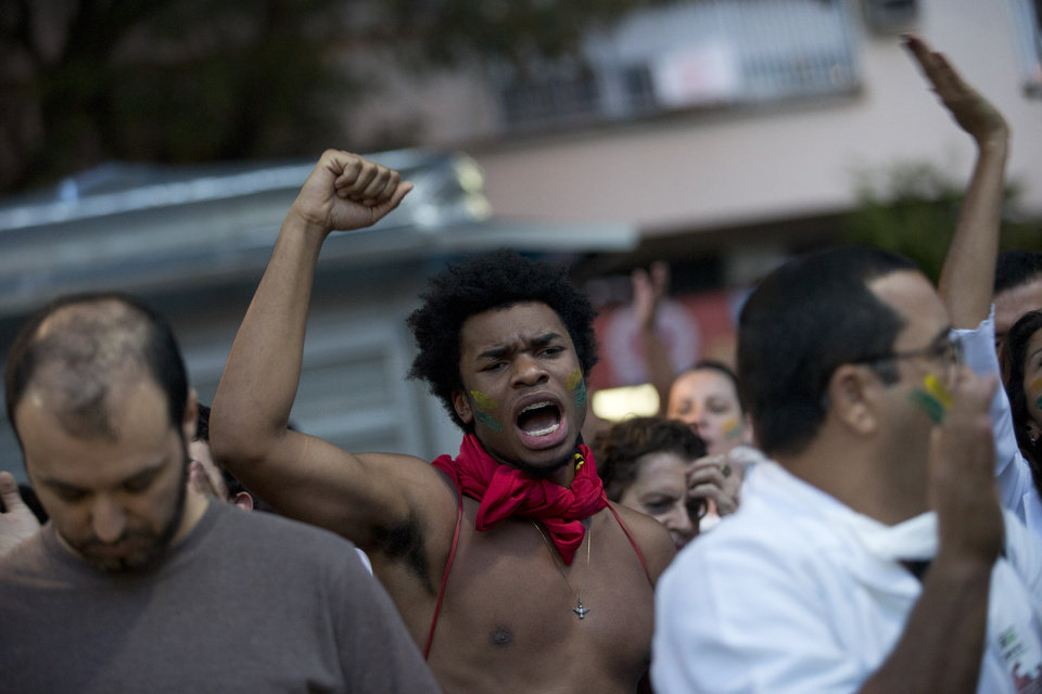 Photo - A man shouts slogans during an anti-government protest in the Ipanema neighborhood, in Rio de Janeiro, Brazil, Friday, June 21, 2013. The country's president, who is a former leftist guerrilla, has done little more than show brief support for the protesters since the demonstrations began a week ago. That's brought criticism that she has allowed the situation to spiral out of control. Rousseff was to meet Friday with bishops from the Catholic Church about the possible impact of the protests on a papal visit that is still scheduled next month. (AP Photo/Silvia Izquierdo)