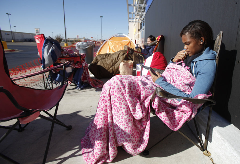 Photo - Nicole Arday, left and Christina Dennis wait for Black Friday shopping bargains at Best Buy on South Pennsylvania in Oklahoma City, Thursday November, 24,  2011. Nicole and Christina are camping out until the doors open. Oklahoman Photo by Steve Gooch