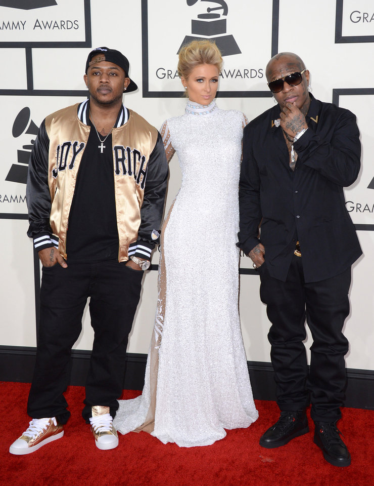 Photo - Mack Maine, from left, Paris Hilton and Birdman arrive at the 56th annual Grammy Awards at Staples Center on Sunday, Jan. 26, 2014, in Los Angeles. (Photo by Jordan Strauss/Invision/AP)
