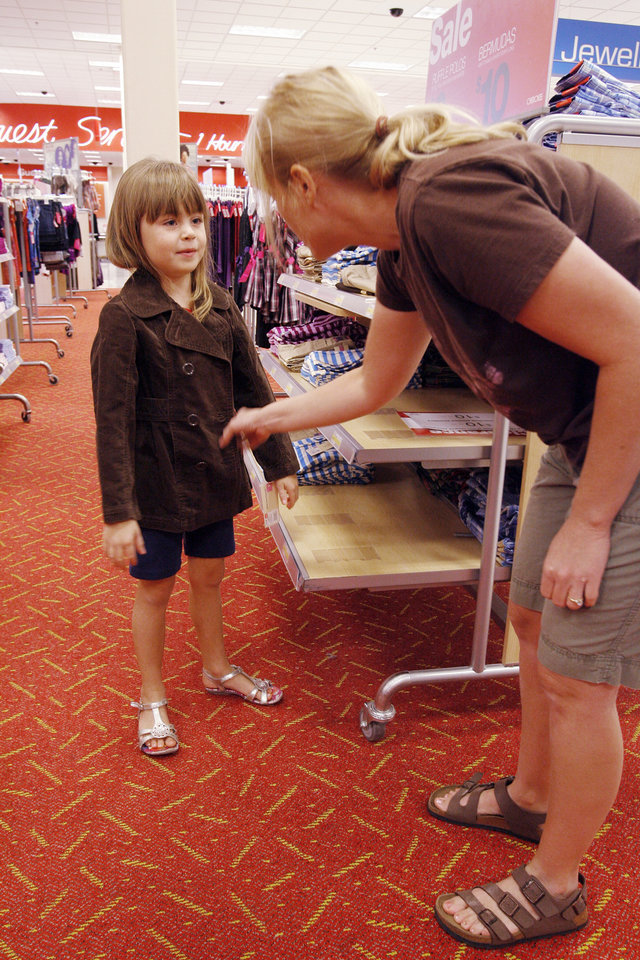 Gracie Hepner, 6, and her mom Kim, from Edmond, shop for back to school clothes at the beginning of the Tax Free Weekend, Friday, August 7, 2009 at the Target on Memorial. Photo By David McDaniel, The Oklahoman.