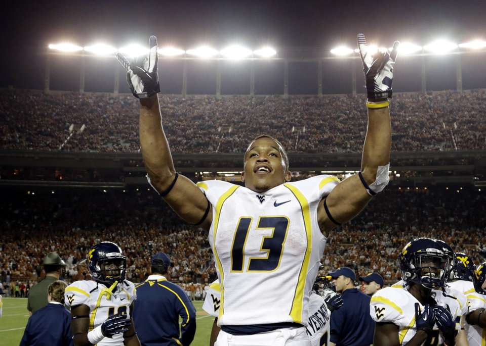Photo -   West Virginia's Andrew Buie reacts after scoring against Texas during the fourth quarter of an NCAA college football game on Saturday, Oct. 6, 2012, in Austin, Texas. West Virginia won 48-45. (AP Photo/Eric Gay)