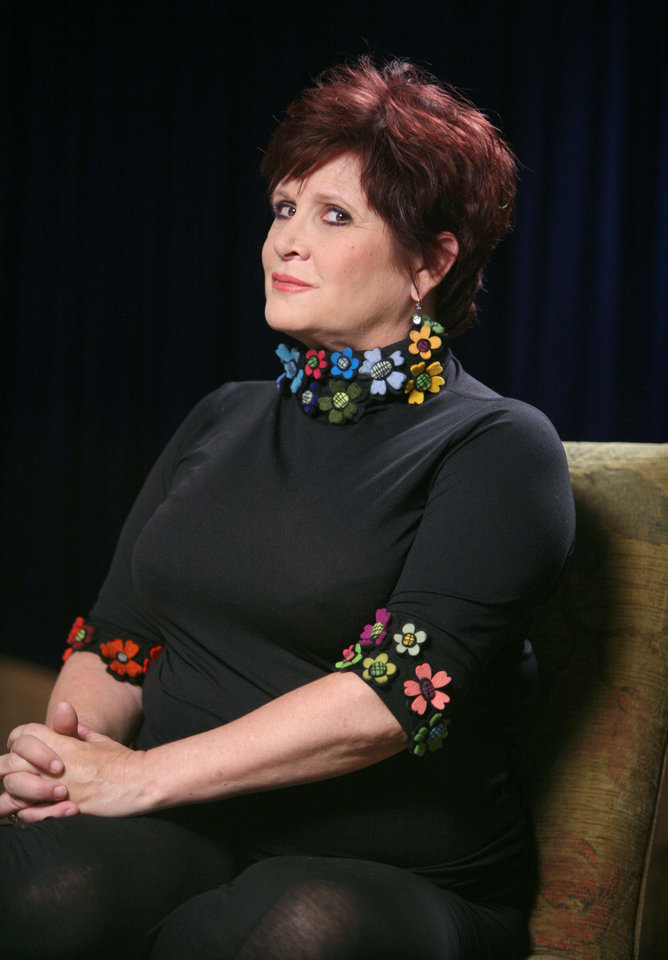 Photo - In this Sept. 15, 2009 photo, actress and writer Carrie Fisher, who stars in