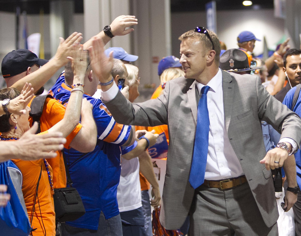 Photo - Boise State head Coach Bryan Harsin enters the Georgia Dome before an NCAA college football game against Mississippi, Thursday Aug. 28, 2014 in Atlanta. (AP Photo/The Idaho Statesman, Darin Oswald)  LOCAL TELEVISION OUT (KTVB 7); MANDATORY CREDIT
