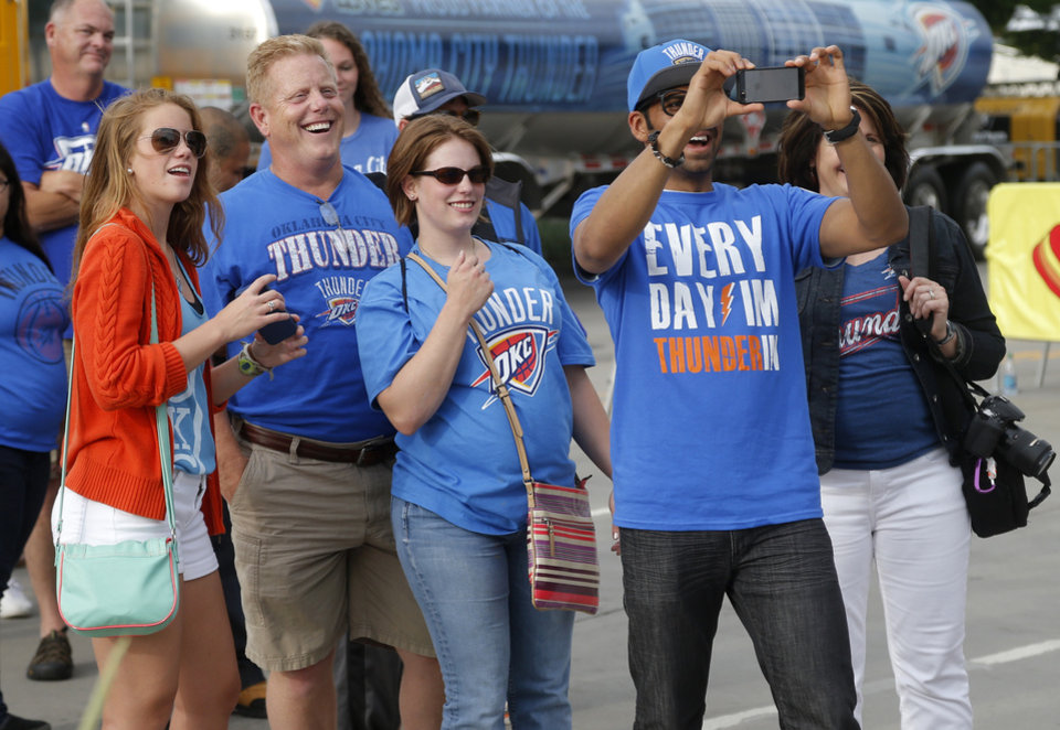 Photo - Thunder fan Dilan Patel teas a photo outside the arena before Game 3 of the Western Conference Finals in the NBA playoffs between the Oklahoma City Thunder and the San Antonio Spurs at Chesapeake Energy Arena in Oklahoma City, Sunday, May 25, 2014. Photo by Bryan Terry, The Oklahoman