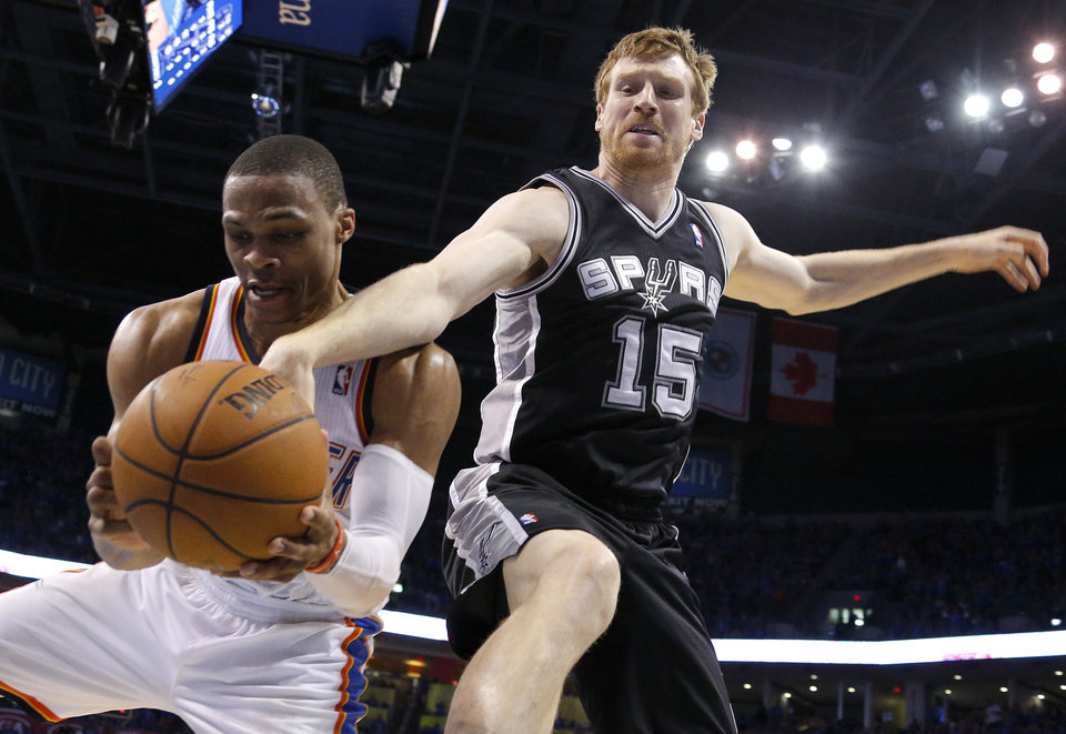 Photo - Oklahoma City's Russell Westbrook (0) reaches for the ball in front of San Antonio's Matt Bonner (15) during Game 3 of the Western Conference Finals in the NBA playoffs between the Oklahoma City Thunder and the San Antonio Spurs at Chesapeake Energy Arena in Oklahoma City, Sunday, May 25, 2014. Photo by Bryan Terry, The Oklahoman