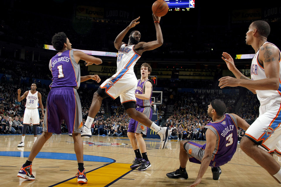 Oklahoma City's James Harden (13) passes the ball in between Phoenix's Josh Childress (1)  and Jared Dudley (3) during the NBA basketball game between the Oklahoma City Thunder and the Phoenix Suns, Sunday, Dec. 19, 2010, at the Oklahoma City Arena. Photo by Sarah Phipps, The Oklahoman