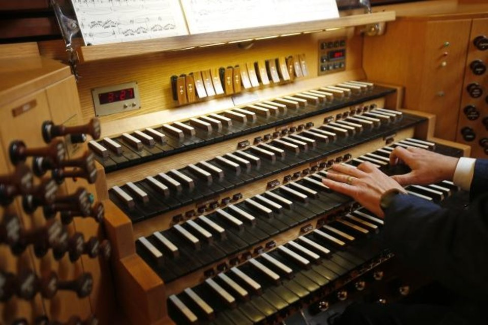 Photo -  Steven McConnell, organist and music minister at First Baptist Church of Oklahoma City, plays the historic pipe organ at the church, 1201 N Robinson. [Bryan Terry/The Oklahoman]