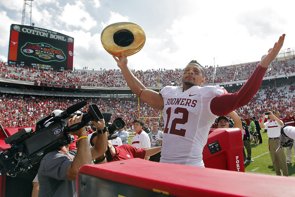 Photo - Travis Lewis celebrates with the Golden Hat trophy after the Sooners defeated Texas 55-17 during the Red River Rivalry college football game between the University of Oklahoma Sooners (OU) and the University of Texas Longhorns (UT) at the Cotton Bowl in Dallas, Saturday, Oct. 8, 2011. Photo by Chris Landsberger, The Oklahoman