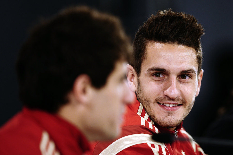 Photo - Spain's Koke, right, and Javi Martinez attend a press conference at the Atletico Paranaense training center in Curitiba, Brazil, Wednesday, June 11, 2014. Spain will play in group B of the Brazil 2014 World Cup. (AP Photo/Manu Fernandez)
