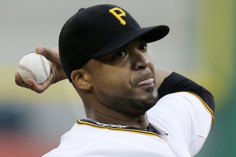 Photo - Pittsburgh Pirates starting pitcher Francisco Liriano  delivers during the first inning of a baseball game against the St. Louis Cardinals in  Pittsburgh Monday, July 29, 2013. (AP Photo/Gene J. Puskar)