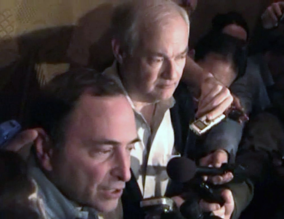 Photo - In this image from video, NHL commissioner Gary Bettman, left, talks to the media as Donald Fehr, executive director of the NHL Players' Association, stands next to him, in New York, early Sunday, Jan. 6, 2013. A tentative deal to end the 113-day NHL lockout was reached early Sunday morning following a marathon 16-hour negotiating session. (AP Photo/The Canadian Press, Chris Johnston)