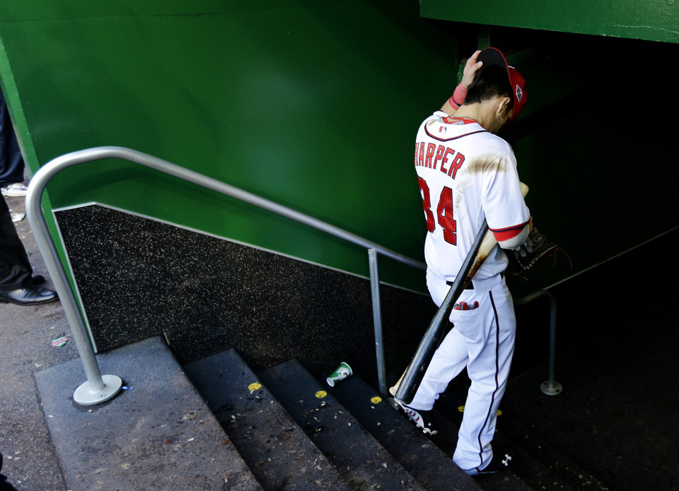 Washington Nationals\' Bryce Harper heads to the clubhouse after Game 3 of the National League division baseball series against the St. Louis Cardinals on Wednesday, Oct. 10, 2012, in Washington. St. Louis won 8-0. (AP Photo/Alex Brandon)
