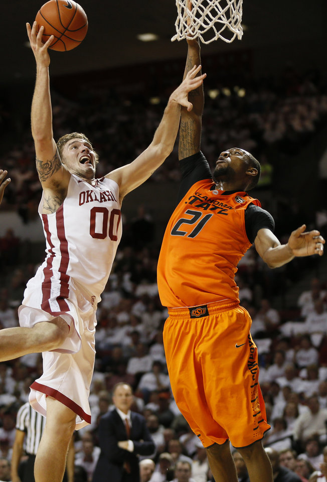 OU's Ryan Spangler (00) takes the ball to the hoop against Oklahoma State's Kamari Murphy (21) in the second half during the NCAA men's Bedlam basketball game between the Oklahoma State Cowboys (OSU) and the Oklahoma Sooners (OU) at Lloyd Noble Center in Norman, Okla., Monday, Jan. 27, 2014. OU won, 88-76. Photo by Nate Billings, The Oklahoman