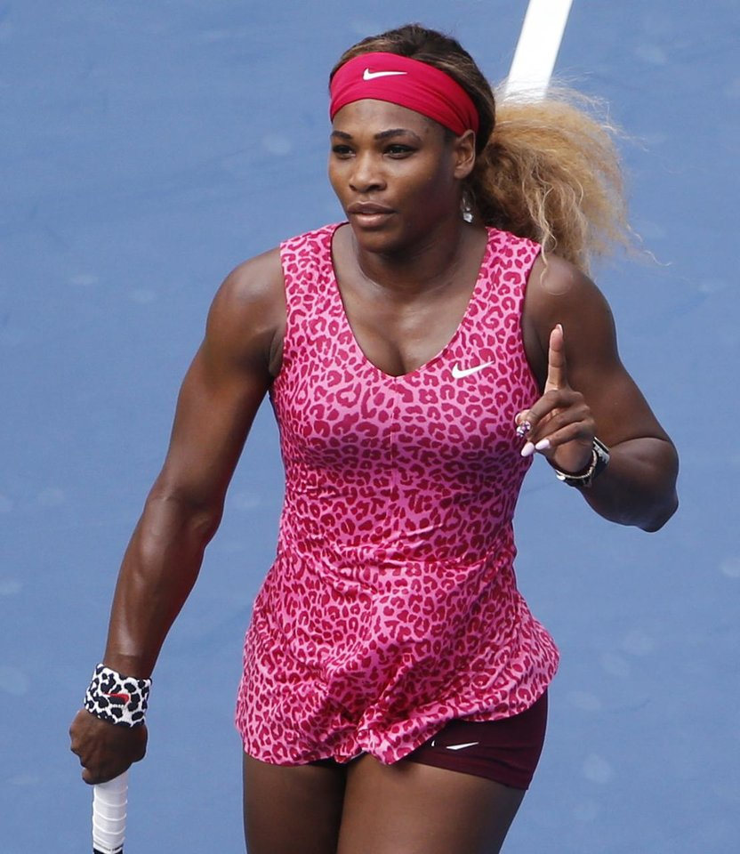 Photo - Serena Williams, of the United States, reacts after defeating Kaia Kanepi, of Estonia, during the fourth round of the 2014 U.S. Open tennis tournament, Monday, Sept. 1, 2014, in New York. (AP Photo/Seth Wenig)