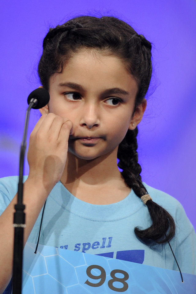 "Photo - Rosie Shultz, 10, of Shreveport, La., reacts as she missspells the word ""zamzummim"" during the 2015 Scripps National Spelling Bee in Oxon Hill, Md., Wednesday, May 27, 2015. (AP Photo/Cliff Owen)"