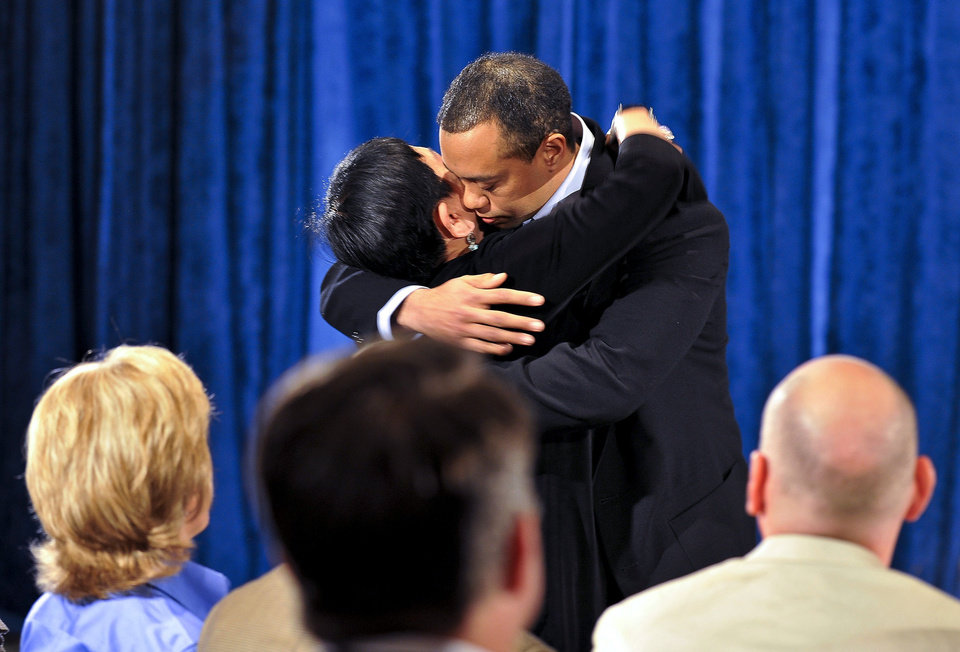 Photo - Tiger  Woods hugs his mother Kultida  Woods after making a statement at the Sawgrass Players Club, Friday, Feb. 19, 2010, in Ponte Vedra Beach, Fla. (AP Photo/Lori Moffett, Pool)