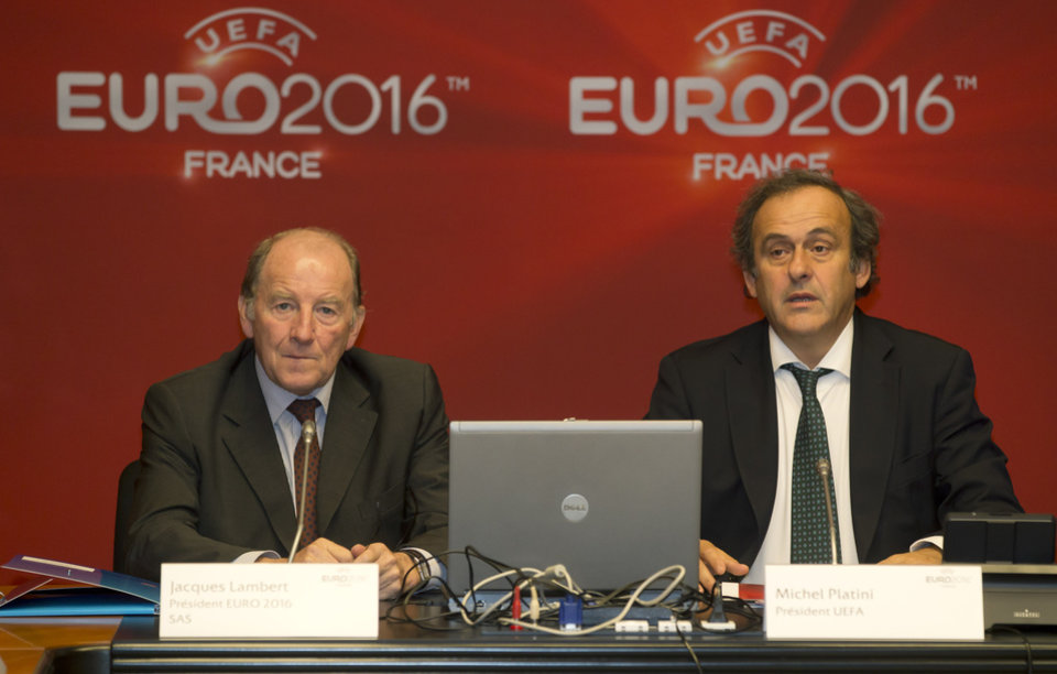 Photo -   President of the EURO 2016 organizing committee Jacques Lambert, left, and UEFA President Michel Platini, right, attend a meeting to prepare the European Championship in France, at the headquarters of the French Football Federation in Paris, Tuesday, Oct. 23, 2012. (AP Photo/Michel Euler)
