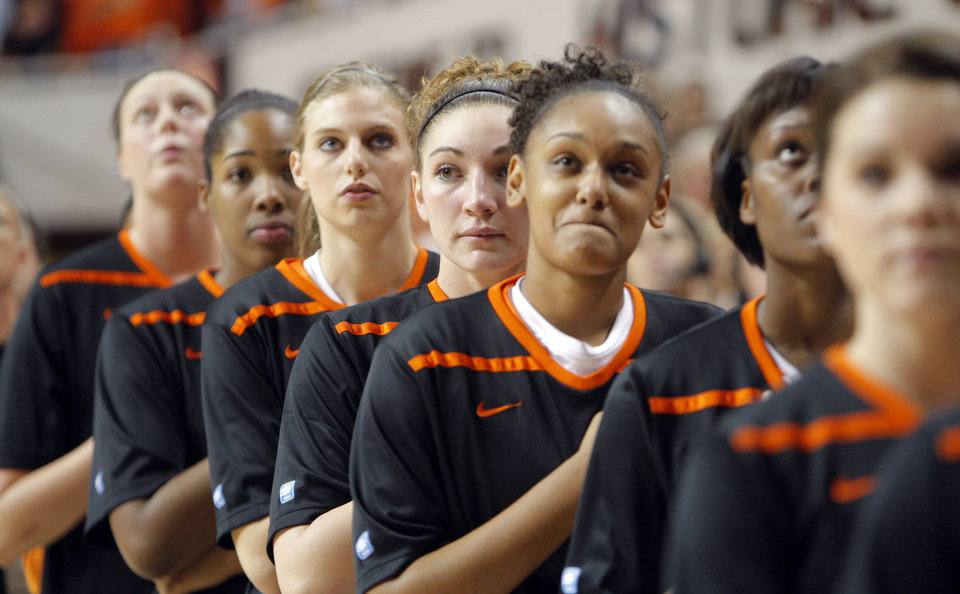 Photo - Oklahoma State players stand during the National Anthem before the women's college game between Oklahoma State University and Coppin State at Gallagher-Iba Arena in Stillwater, Okla.,  Saturday, Nov. 26, 2011.  Photo by Sarah Phipps, The Oklahoman
