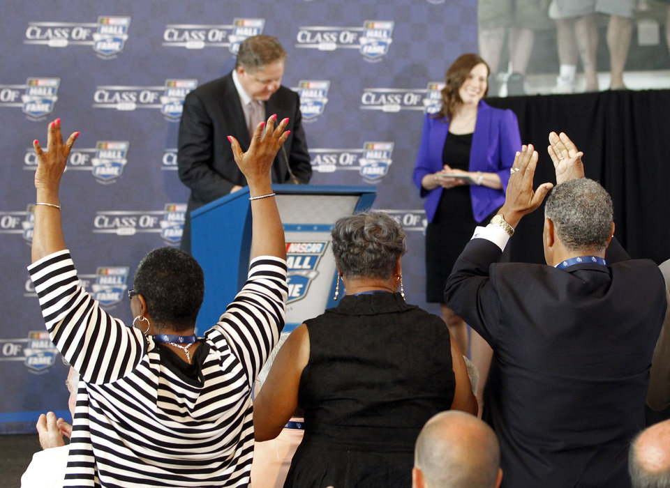 Photo - Family members of driver Wendell Scott react after Scott was named as one of five inductees into the NASCAR Hall of Fame class of 2015, in Charlotte, N.C., Wednesday, May 21, 2014. (AP Photo/Terry Renna)