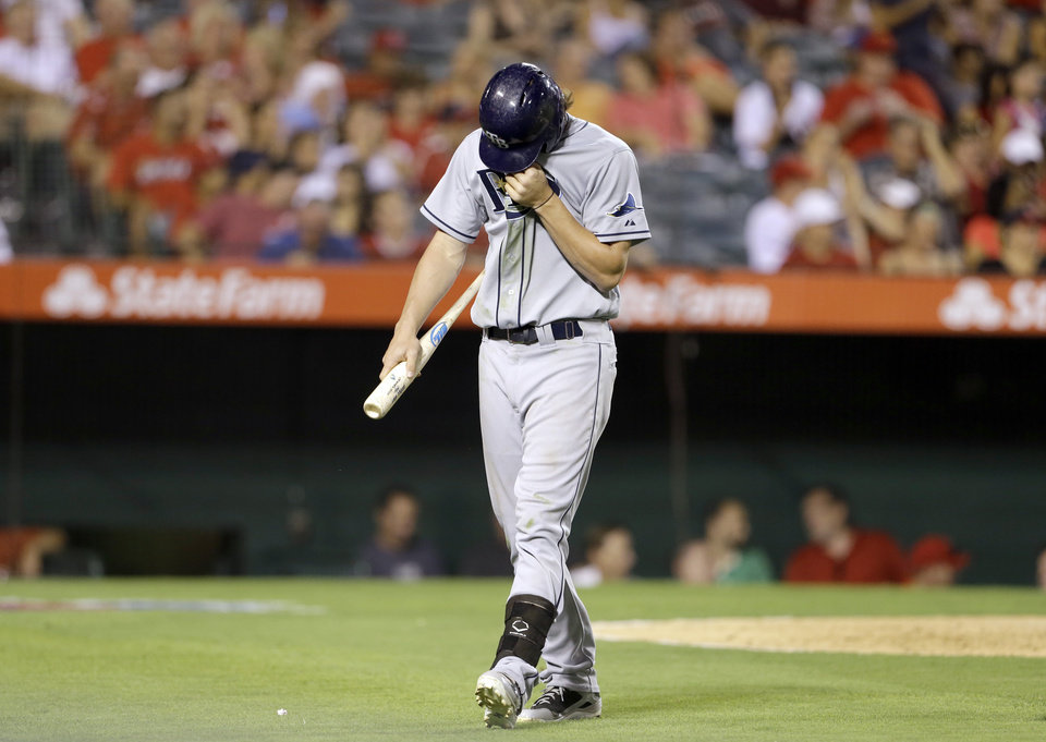 Photo - Tampa Bay Rays' Will Myers walks off the field after striking out with the bases loaded, in the fifth inning of a baseball game in Anaheim, Calif., Monday, Sept. 2, 2013. (AP Photo/Reed Saxon)