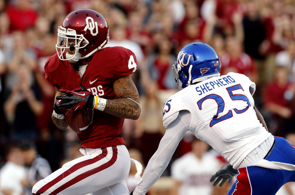 Oklahoma Sooners's Kenny Stills (4) tucks a pass and scores trailed by Brandon Bourbon during the college football game between the University of Oklahoma Sooners (OU) and the University of Kansas Jayhawks (KU) at Gaylord Family-Oklahoma Memorial Stadium in Norman, Okla., on Saturday, Oct. 20, 2012. Photo by Steve Sisney, The Oklahoman