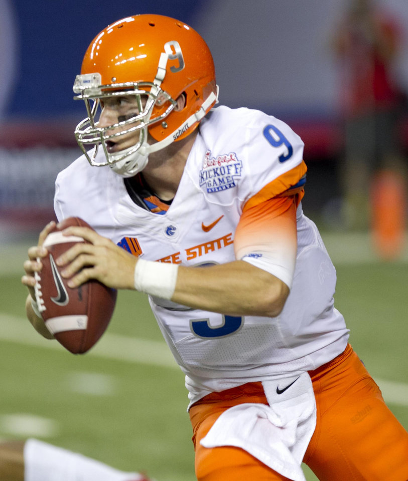 Photo - Boise State quarterback Grant Hedrick looks for a receiver down field during an NCAA college football game, Thursday Aug. 28, 2014 in Atlanta. (AP Photo/The Idaho Statesman, Darin Oswald)  LOCAL TELEVISION OUT (KTVB 7); MANDATORY CREDIT