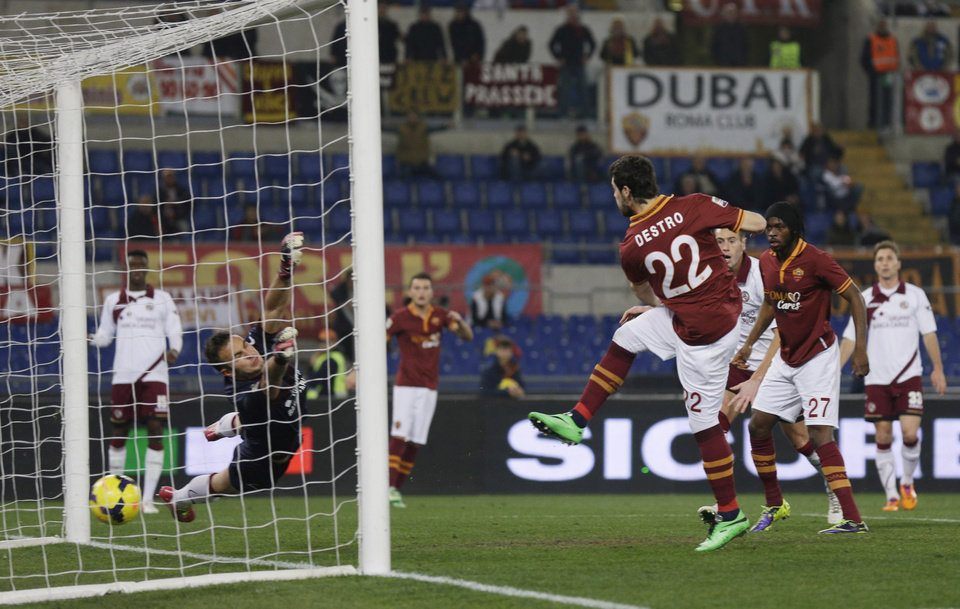 Photo - AS Roma forward Mattia Destro, right, scores a goal  during an Italian Serie A soccer match between AS Roma and Livorno at Rome's Olympic stadium, Saturday, Jan. 18, 2014. (AP Photo/Alessandra Tarantino)