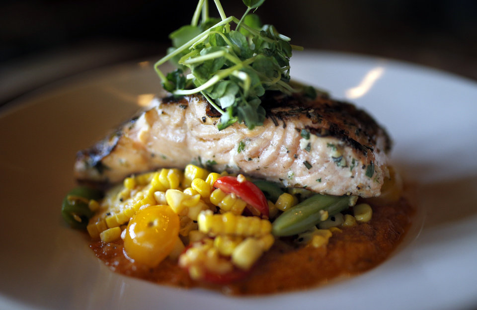 Photo - A salmon dish is pictured at the Whiskey Cake Kitchen and Bar in Oklahoma City, Thursday, July 3, 2014. Photo by Sarah Phipps, The Oklahoman