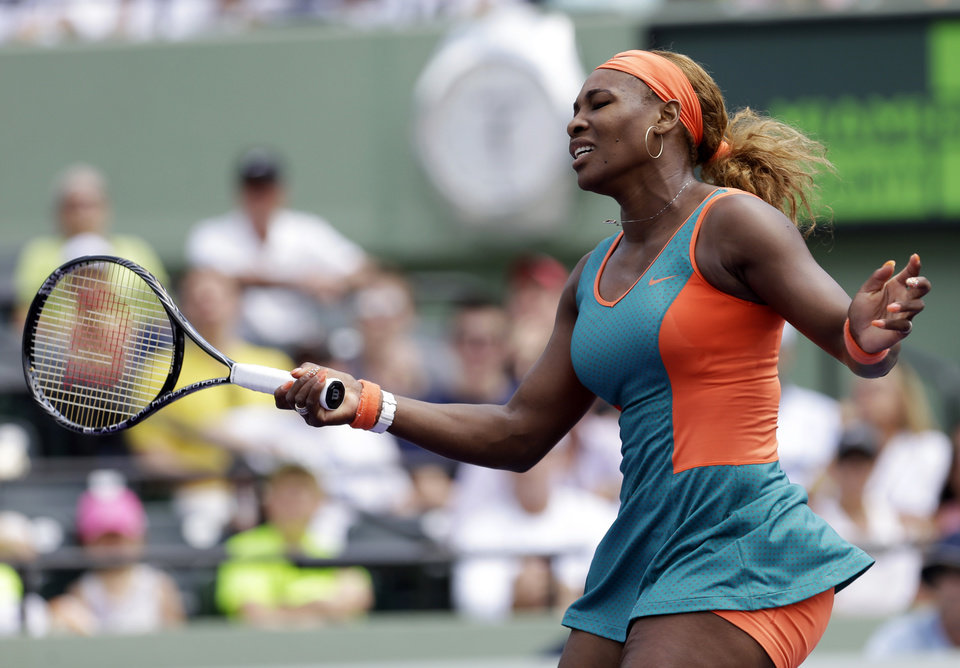 Photo - Serena Williams reacts after losing a point to Maria Sharapova, of Russia, at the Sony Open Tennis tournament in Key Biscayne, Fla., Thursday, March 27, 2014. (AP Photo/Alan Diaz)