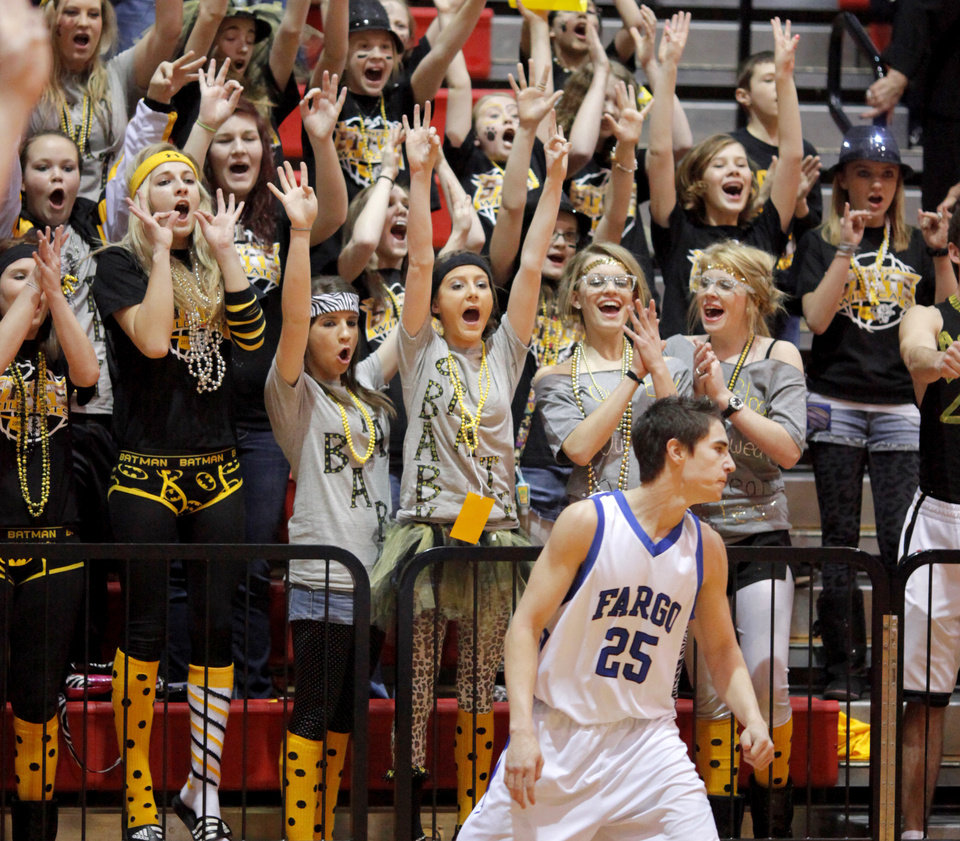 Arnett fans react behind Fargo's Tyler Howard after an Arnett basket  in first round of the Class B state basketball tournament at Carl Albert in Midwest City, Thursday, March 1, 2012. Photo by Bryan Terry, The Oklahoman