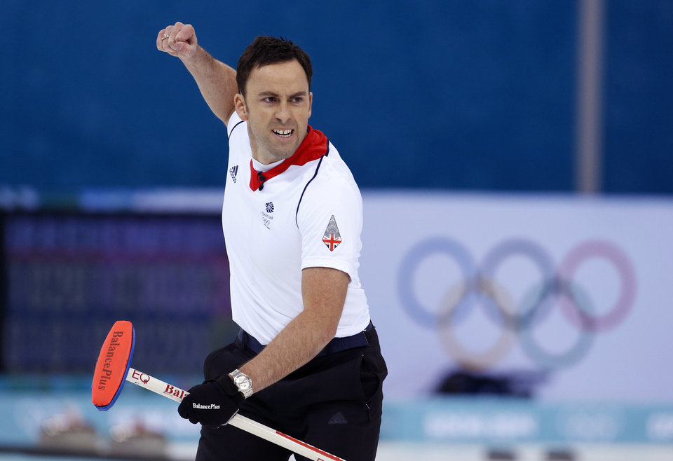 Photo - Britain's skip David Murdoch celebrates after delivering the last rock to defeat Sweden during the men's curling semifinal game at the 2014 Winter Olympics, Wednesday, Feb. 19, 2014, in Sochi, Russia. (AP Photo/Robert F. Bukaty)