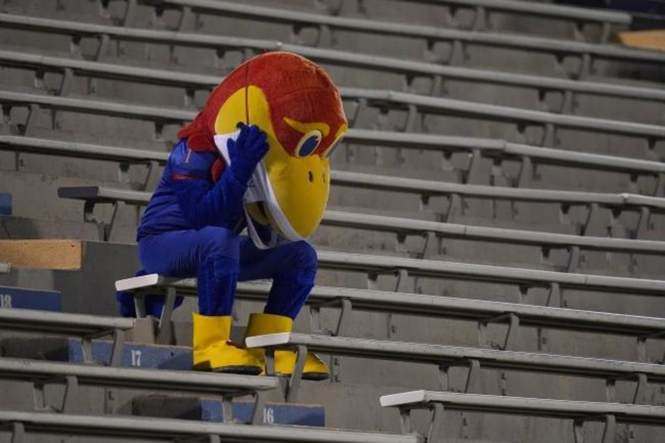 Photo -  Kansas Jayhawk mascot sits in the empty stands during the second half of an NCAA college football game against Coastal Carolina in Lawrence, Kan., Saturday, Sept. 12, 2020. Coastal Carolina defeated Kansas 38-23. (AP Photo/Orlin Wagner)