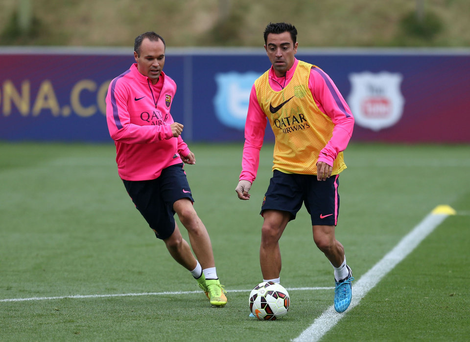Photo - Barcelona's Xavi, right,  and Andres Iniesta, run, during a pre-season training session, at St George's Park, Burton-Upon-Trent,  England,  Friday Aug.  1, 2014. (AP Photo/PA, Simon Cooper) UNITED KINGDOM OUT