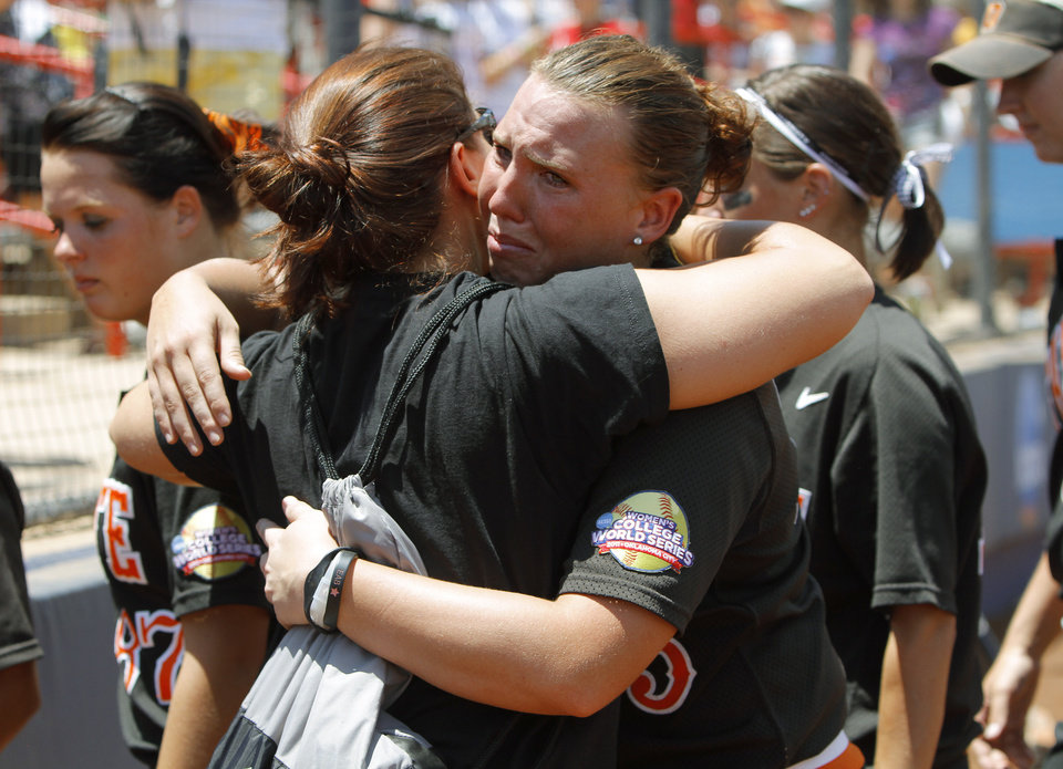 Photo - Oklahoma State's Ashley Boyd (25) reacts after OSU's loss during a Women's College World Series softball game between Oklahoma State University and California at ASA Hall of Fame Stadium in Oklahoma City, Saturday, June 4, 2011. California won, 6-2. Photo by Bryan Terry, The Oklahoman
