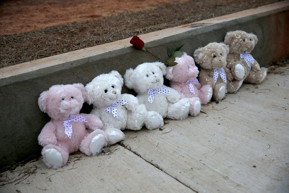Photo - Memorials are pictured at the sight of a hit and run incident in Moore at Moore High School in Moore, Okla., Tuesday, Feb. 4, 2020.  [Sarah Phipps/The Oklahoman]