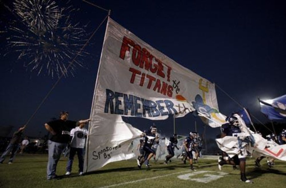 The Shawnee Wolves run onto the field before the high school football game between Shawnee and Carl Albert Friday, 0ct. 2, 2009, at the Jim Thorpe Stadium in Shawnee, Okla. Photo by Sarah Phipps, The Oklahoman