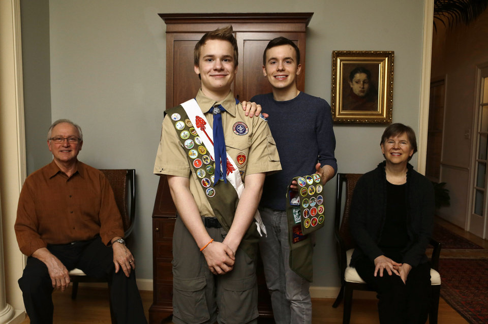 In this Monday, Feb. 4, 2013 photo, Pascal Tessier, 16, center left, a Boy Scout, and his brother Lucien Tessier, 20, who had earned the rank of Eagle Scout, pose for a portrait with their parents, Oliver Tessier, left, and Tracie Felker, at their home in Kensington, Md. The two Tessier boys enjoyed Cub Scouts, progressed to Boy Scouts, and continued to thrive there even as many in their troop became aware that each boy was gay. The family is grateful for that, but fervently hopes the BSA's top leaders officially scrap the ban so that open acceptance becomes the norm for Scout units nationwide. (AP Photo/Jacquelyn Martin)