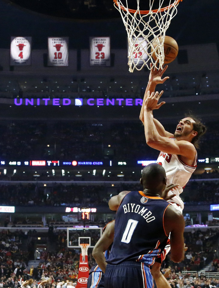 Chicago Bulls center Joakim Noah shoots over Charlotte Bobcats forward Bismack Biyombo (0) during the first half of an NBA basketball game, Monday, Jan. 28, 2013, in Chicago. (AP Photo/Charles Rex Arbogast)