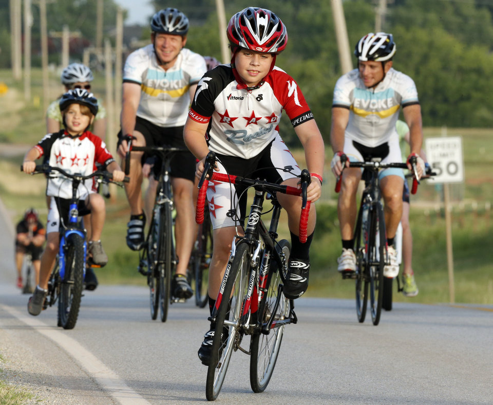 Photo -  Gibbon Edgar, 11, leads a group of riders east on Robinson Street during the Norman Conquest bike ride that benefits the J.D. McCarty Center. PHOTO BY STEVE SISNEY, THE OKLAHOMAN   STEVE SISNEY