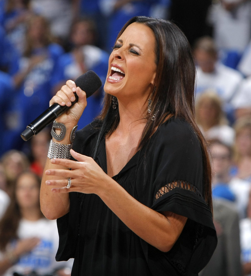 Photo - Sara Evans sings the national anthem before Game 2 of the NBA Finals between the Oklahoma City Thunder and the Miami Heat at Chesapeake Energy Arena in Oklahoma City, Thursday, June 14, 2012. Photo by Sarah Phipps, The Oklahoman