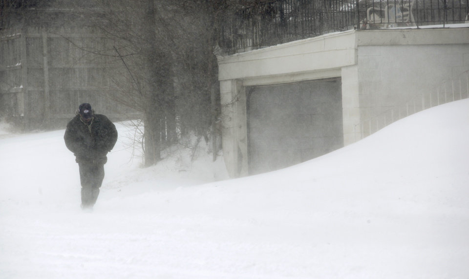 Photo - A man walks north through blowing snow on Penn near NW 36 during a winter storm in Oklahoma City, Tuesday, Feb. 1, 2011. Photo by Nate Billings, The Oklahoman