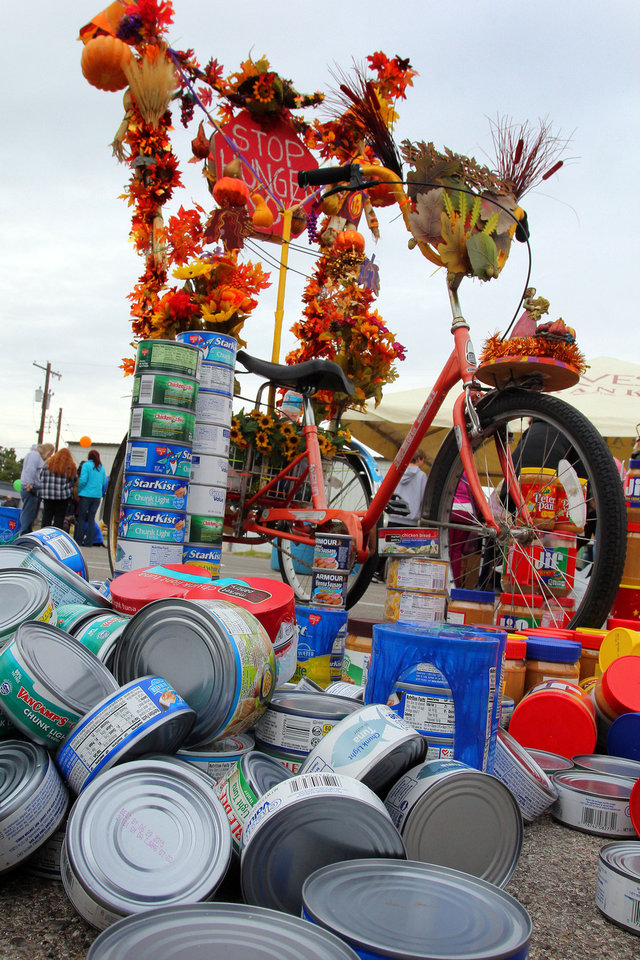 Donations of tuna and peanut butter, a suggested entry fee for joining the Cleveland County CROP Walk to Stop Hunger, are piled near the start of the three-mile trek. PHOTO BY HUGH SCOTT, FOR THE OKLAHOMAN <strong>HUGH SCOTT</strong>