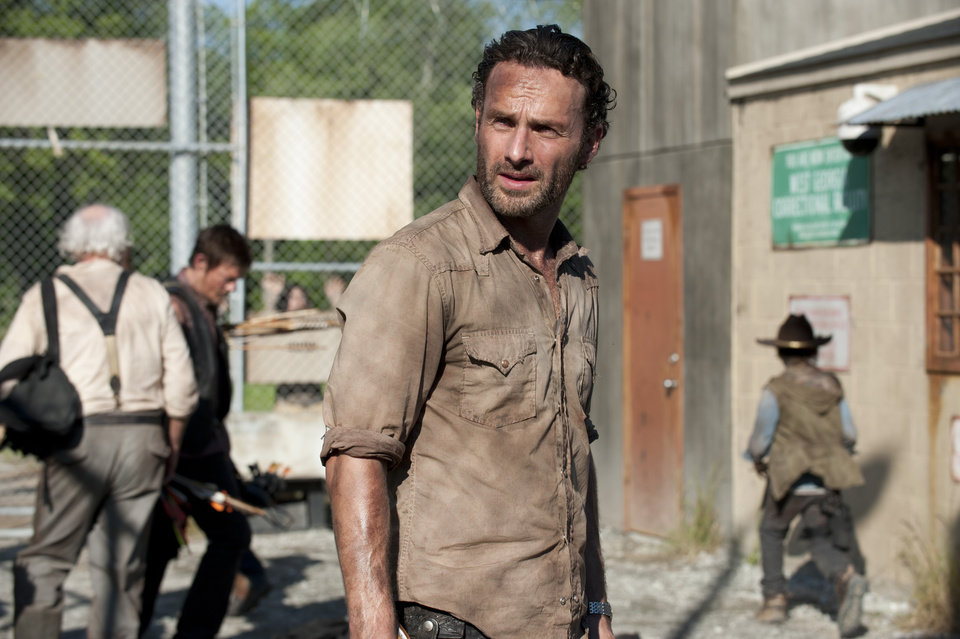 "In this publicity photo provided by AMC, actor, Andrew Lincoln, as Rick Grimes, center, is shown in a scene from AMC's ""The Walking Dead,"" Season 3, Episode 1. (AP Photo/AMC, Gene Page) ORG XMIT: CAPH850"