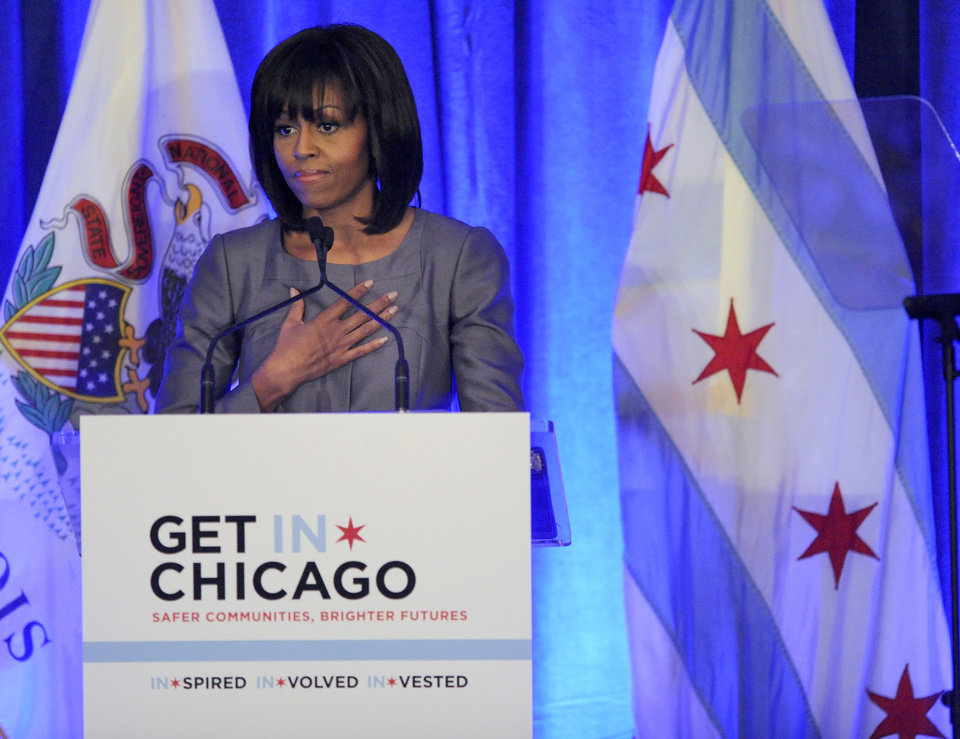 Photo - First lady Michelle Obama speaks about 15 year-old Hadiya Pendleton who was shot and killed on the south side of Chicago earlier this year, during a luncheon at the Chicago Hilton in Chicago, Wednesday, April 10, 2013. The first lady is visiting Chicago for a discussion with Chicago Mayor Rahm Emanuel and civic leaders on ways to combat youth violence. (AP Photo/Paul Beaty)