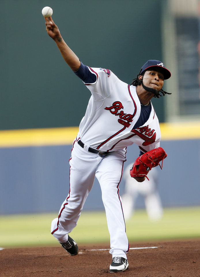 Photo - Atlanta Braves starting pitcher Ervin Santana (30) works in the first inning of baseball game against the Miami Marlins  in Atlanta, Wednesday, July 23, 2014. (AP Photo)