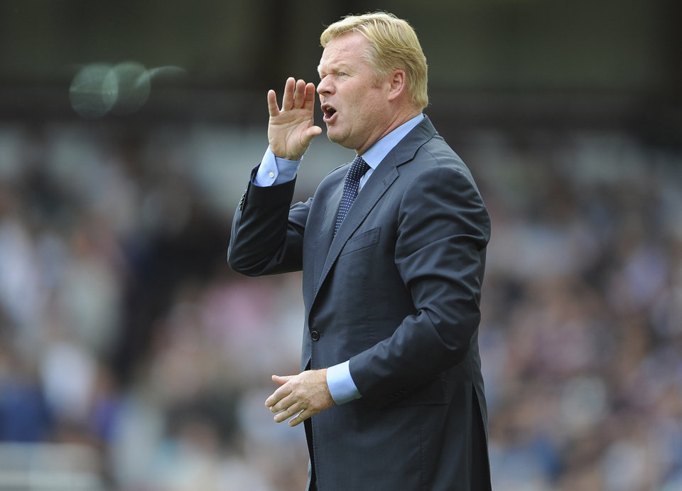 Photo - Southampton's manager Ronald Koeman instructs players during their match against West Ham United during their English Premier League soccer match at Upton Park, London, Saturday Aug. 30, 2014. (AP Photo / Daniel Hambury, PA) UNITED KINGDOM OUT - NO SALES - NO ARCHIVES
