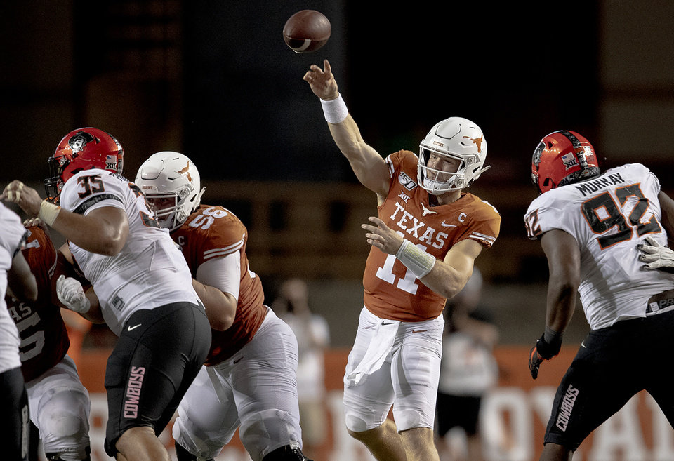 Photo - Texas quarterback Sam Ehlinger (11) throws the ball against Oklahoma State during an NCAA college football game on Saturday, Sept. 21, 2019, in Austin, Texas. (Nick Wagner/Austin American-Statesman via AP)