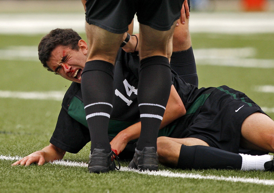 Blood drips from the nose of Norman North's Mauro Cichero after a collision in the boys 6A state championship soccer game in Newcastle, Okla., Saturday, May 12, 2012. Photo by Bryan Terry, The Oklahoman